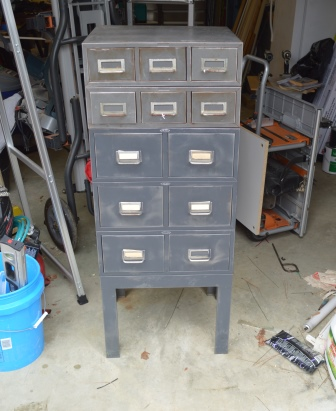 An old card file cabinet with 2 smaller sections on top